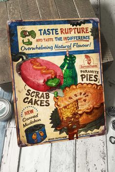 Taste the flavours of RUPTURE FARMS! Decorative tin wall sign with punched corner holes, for hanging or screwing. Official Oddworld™ Merchandise. -...