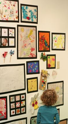 """Black Masking Tape """"Frames"""" to display children's art: Art Room from Fun at Home with Kids"""
