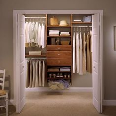 Modern Bedroom Decor with White Small Walk-In Closets, 1 Shelf Shoe Cabinet, and 3 Dress Hanging Space