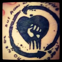 """My Tattoo     Rise Against <3  """"How we survive is what makes us who were are"""" I like this but for a band or rapper or single I like & their logo & my fav quote"""
