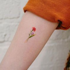 27 Beautiful Carnation Tattoo Ideas and Their Symbolism 27 Beautiful Carnation Tattoo Ideas and Their Symbolism Lila Tattoos, Small Girl Tattoos, New Tattoos, Tatoos, Celtic Tattoos, Marigold Tattoo, Tulip Tattoo, Carnation Flower Tattoo, Red Carnation