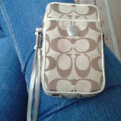 Authentic Coach Wristlet Used a handful of times.    Gold trim.   Pet free-smoke free home . Coach Accessories