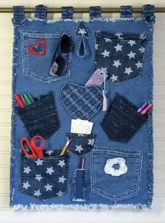 Denim Wall Organizer Handmade from Recycled Blue Jean Denim with Lots of Pockets, Decorative Embellishments and Fringed Edges Mehr Jean Crafts, Denim Crafts, Diy And Crafts, Artisanats Denim, Denim Rug, Denim Flowers, Denim Ideas, Recycle Jeans, Old Jeans