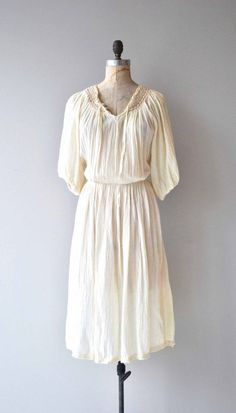 Vintage 1970s cream cotton gauze dress with cotton crochet neckline, tie collar, short sleeves, elastic waist and full skirt. So easy to wear. --- M E A S U R E M E N T S --- fits like: medium/large bust: 45 waist: 26-37 hip: free length: 47 brand/maker: Rothschild for Rosani condition: excellent to ensure a good fit, please read the sizing guide: http://www.etsy.com/shop/DearGolden/policy ✩ more vintage dresses ✩ http://www.etsy.com/shop&#...