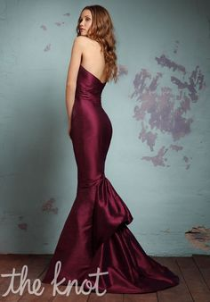 Gown features floral detail and ruching.