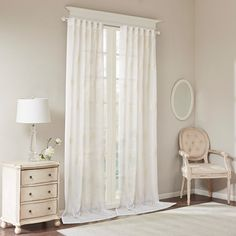 "Delicate and sophisticated, our Bombay Massa window panel will soften any room for a simple and elegant update. Lightweight sheer fabric features beautiful embroidered medallions in light ivory, creating a little contrast for a soft and updated look. Available in standard or longer length for beautiful pooling and a dramatic effect. Hang on rod pocket or back tabs for a tailored look, fits up to 1.25"" diameter rod."