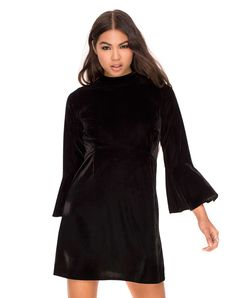 Channel your inner goth in our cute velvet babydoll dress. With an empire waistline, three quarter flounces flared sleeves, a high neck and cheeky cut out to the back.