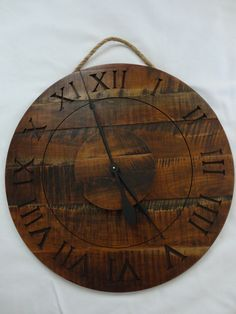 Salvaged Wood Wall Clock In Dark Walnut.  Scroll saw out the numbers with solid contrasting wood backing.    You could cut round on lathe.  Cut smaller circle for center for contrast and to move out the hands a bit.  Simple and nice!