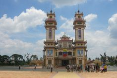 The lavish temple of the Cao Dai religion that includes Buddha, Mohammed, Joan of Arc, and Victor Hugo