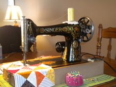 """This 1928 Singer 66 Red Eye is """"Doris"""", named for the previous owner who bought her new.  Michelle found in the basement at an estate sale and bought her for a mere $20.00.  She still sews a perfect stitch.....a gorgeous machine!"""