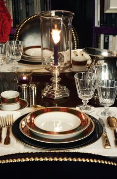 A classic plaid pattern with elegant gold accents, Ralph Lauren Home Duke tabletop collection is designed to create a stunning, festive table setting.