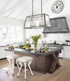 A modern country kitchen is adorned with unique accents, such as a leaded glass kitchen island light and stools that look like animal legs. (via Kitchen Inspirations / abode love: a man& home is his wife& castle) Küchen Design, House Design, Interior Design, Design Ideas, Design Trends, Interior Decorating, Design Inspiration, 1960s Interior, Decorating Kitchen