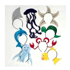 Ocean creatures headbands! Octopus, crab, shark fin, fish, starfish, and jellyfish headbands. These are made with a headband, laser cut fabric and hidden wires to stand straight up. Great for birthday parties and other events or for photo booth props. One size fits all: babies 6 months and
