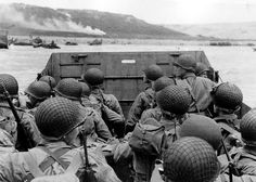 American troops approaching Omaha Beach during the Invasion of Normandy on D-Day…