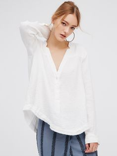 Changing Horizons Pullover | Crinkly and soft cotton pullover featuring a deep V-neckline with button closures on the placket. Unfinished raw rounded hem.