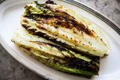 Hearts of romaine lettuce, painted with a herb vinaigrette, and grilled. Served whole, or chopped for a grilled salad.