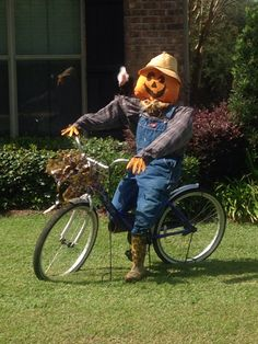 scarecrow on a bike