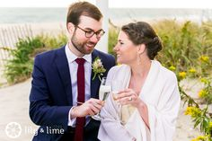 """A toast on the beach after you just said, """"I do"""" - what could be better? Cheers to the weekend!"""