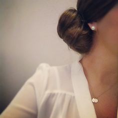Pearls and low knotted bun