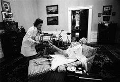 First Lady Betty Ford Politely Dressing a Skeleton. Photo Credit: National Archives. Photograph of First Lady Betty Ford and Her Secretary Nancy Howe Dressing a Skeleton for Halloween in the President's Chair in His Private Study on the Second Floor of the White House, 10/30/1974,Series: Gerald R. Ford White House Photographs, 08/09/1974 – 01/20/1977.