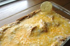 Welcome to paradise in a dip. Texas Trash Dip!  It's a refried beany, creamy, cheesy, taco-y amazing mixture.  It is now my go-to dip for any and all social functions. I brought it to my scrapbook club and they loved it!  This is what it looks like before it's popped in the oven with cheese on top       I found this amazing recipe here  Warm Bean Dip AKA Texas Trash Dip (from above website)    Recipe adapted from: allrecipes.com  1 (8 ounce) package cream cheese, softened  1 cup sour cream  2 ca