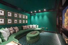 The most popular homes for sale this year include this property in London's fashionable Primrose Hill, which has a striking emerald green cinema room