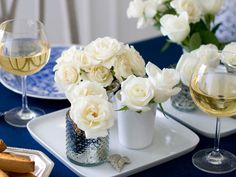 No-Fuss Centerpiece  To create a pretty yet simple centerpiece, place square dinner plates down the center of the table. Arrange a mixture of mercury glass and milk-glass votive holders filled with flowers on each plate