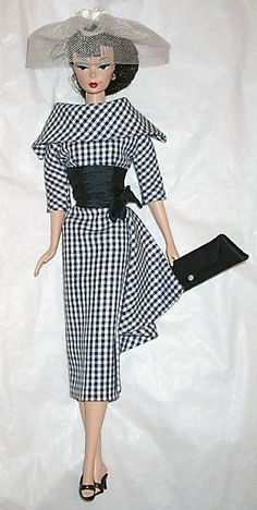 Day dress in navy cotton checks, navy silk waistline, veil with white rosebuds, silk envelope.