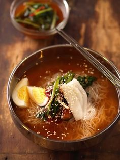 냉면 Korean Cold Noodle soup, with chewy clear noodles, beef, asian pear, seasoned with hot mustard and vinegar