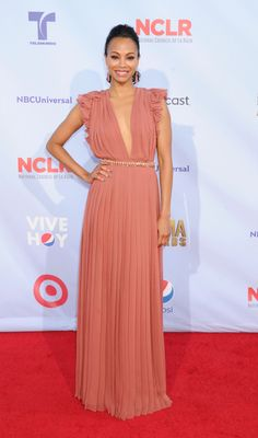 "Presenter and nominee Zoe Saldana wore a Gucci Cruise 2013 desert rose silk georgette sleeveless pleated gown with jeweled belt to the 2012 NCLR Alma Awards in Pasadena, California on September 16, 2012. She was nominated for best movie actress in a drama/adventure for her role in ""Colombiana."""
