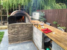 Pizza oven and bar. Still need the finishing touches Pizzaoven oven EasySunday bread sausages cured meat Smokey doingitright food foodporn bbq
