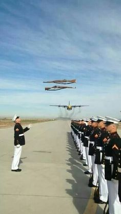 US Marine Corps Silent Drill Platoon with Blue Angels Fat Albert flyover.