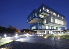 University building featuring glass boxes that cantilever from its concrete core.