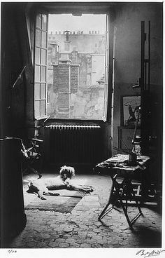 Picasso's art studio, Paris 1920's. Behind every great man there is a dog.