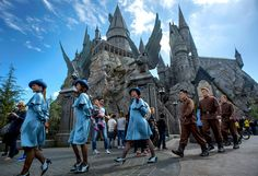 Beauxbatons and Durmstrang performers pass the Hogwarts Castle at Universal Studios Hollywood's new attraction The Wizarding World of Harry Potter in Los Angeles, Calif. March 11, 2016.    (Photo by Leo Jarzomb/Los Angeles Daily News)