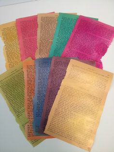 Book pages sprayed with Design Master Tint IT Multi-Use Spray Paint. Top Row: Sunflower, Strawberry, Sepia, Jade, Pinkalicious. Bottom Row: Chartreuse, Mango, Sapphire Plum, Gold Shimmer.