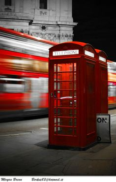 London, red phone box and bus by Moyan Brenn DeLight