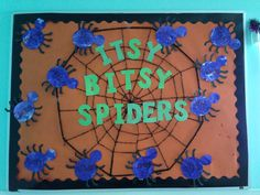Toddler Halloween bulletin board. I had the kids paint white paper with purple paint then cut out a spider shape from that paper. I just cut the spider legs from black paper. The spider web is from Walmart