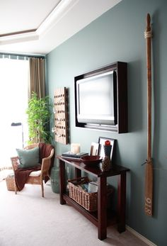 Mount a frame around your TV - Love this idea! Try using Command™ Picture Hanging Strips to achieve this look without damaging your walls!