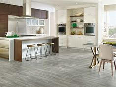 Armstrong LUXE Plank with Rigid Core Concrete Structures Soho Gray. Vinyl plank flooring.