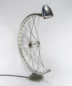 Really cute Bespoke Bicycle Desk Lamp made with a bicycle wheel and gears, with built-in on/off switch. Equipped with E14 bulb fitting and standard plug so