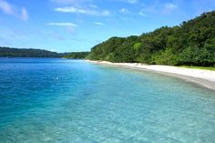 Peucang Island: The beach is a small part of the wildlife reserve, dominated by a tropical forest ecosystem. (Photo by I...