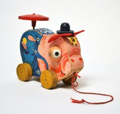 Pinky Pig- Vintage Fisher Price 1955 / This is an extremely rare wooden toy. It's the first in a series of 6 different FP toys that span from 1955 -1965. This particular model was the only one to have 3-D eyes & in 1958 it was replaced with a flat litho eye.