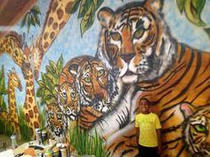 JUNGLE STREET ART MURAL oversized huge colossal mural jungle giraffe lion tiger trees grass grassland spray paint graffiti  NYC (347) 223-7533  info@muralpainternyc.com www.muralpainternyc.com