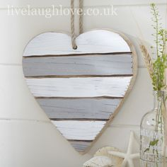 With its subtle painted tones on a tongue n grove wooden fish this piece would look ship shape in any nautical themed room. The paint is lightly distressed to reveal the wood grain in the pine and hangs from rustic rope. Nautical Bedroom, Nautical Wall Decor, Nautical Bathrooms, Nautical Theme, Shabby Chic Accessories, Seaside Theme, Wooden Fish, Heart Garland, Pallet Art