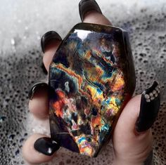 "unearthedgemstones: "" mineraliety: "" Coffin shaped Labradorite getting a bath with @kelleye_ ////// www.instagram.com/kelleye_ www.mineraliety.com "" Those colors are magical! """
