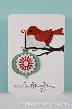 handmade Christmas card ,,, in German ... Cottage Cutz dies: Winter Bird with Ornament ... luv the chubby red bird ...