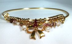 Pretty in pink bangle with pearls, pink tourmaline and all tied up with a bow.