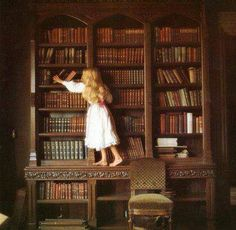 This reminds me of my sister in her room FULL of books -- even more than in this picture!