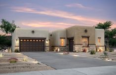Pueblo-style home exterior with a flat roof and touches of stone as well as easy to maintain front yard landscaping. Flat Roof House, House Front, Front House Landscaping, House Landscape, New Home Builders, House Plans, Home Improvement, New Homes, Exterior
